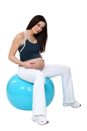 bouncing: Pregnant woman bouncing on a birth ball