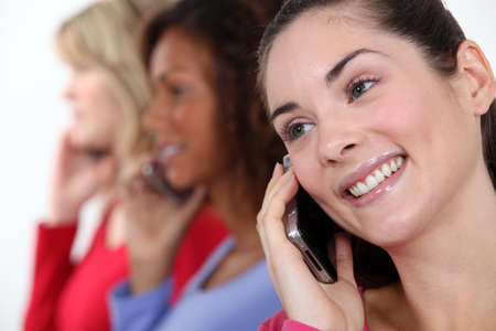 executive affable: Portrait of three women on the phone