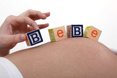 pregnant woman with baby letters on belly photo