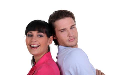 mistrust: Couple stood back to back Stock Photo