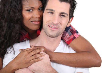 Afro woman and white man hugging photo