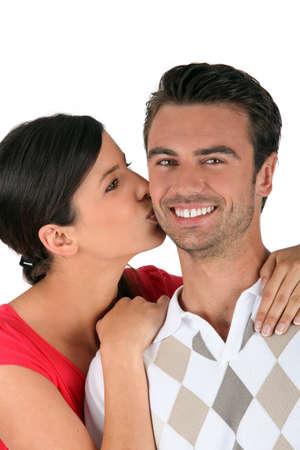 Woman kissing boyfriend on the cheek Stock Photo - 17505957
