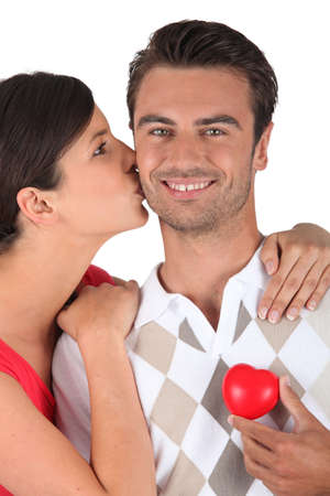 plastic heart: Man holding plastic heart Stock Photo