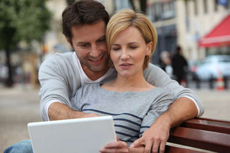 urban environment: A couple seated on a bench Stock Photo
