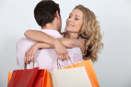 35 40 years: Couple with shopping bags Stock Photo