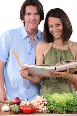 Couple cooking in kitchen photo