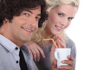 Couple drinking through two straws Stock Photo - 17506057