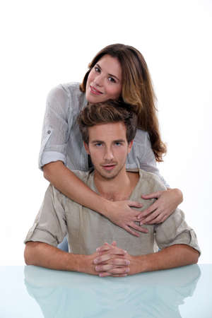 Young man and smiling young woman, studio shot photo