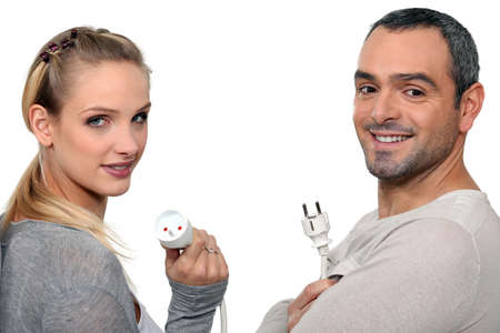 Couple holding electrical cable photo