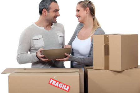 Couple moving in to new home photo