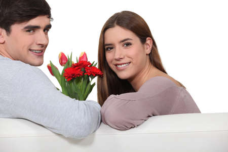 Man offering flowers to girlfriend photo