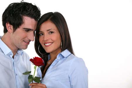 cherishing: man offering his girlfriend a rose