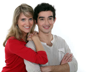 Closeup of a young couple, studio shot photo