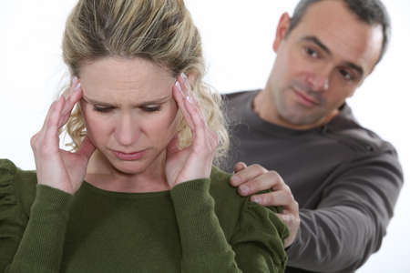 over the shoulders: Woman with a headache Stock Photo