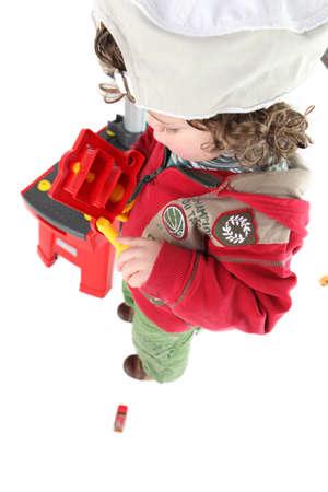 make belief: Child pretending to be a tradesperson