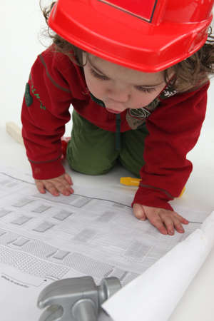 disguised: Baby architect Stock Photo