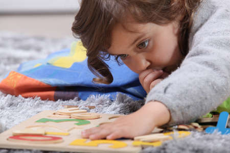 Child playing with a puzzle photo