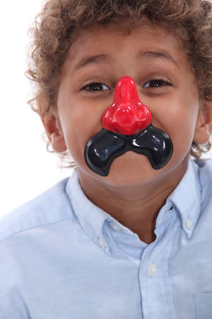 Boy wearing a funny nose photo