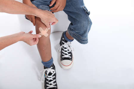 medical dressing: Little boy with hurt knee