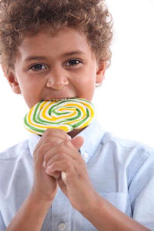 little boy with lollipop photo