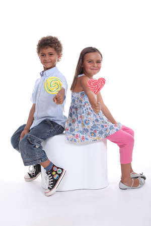 Children with lollipops Stock Photo - 17506028