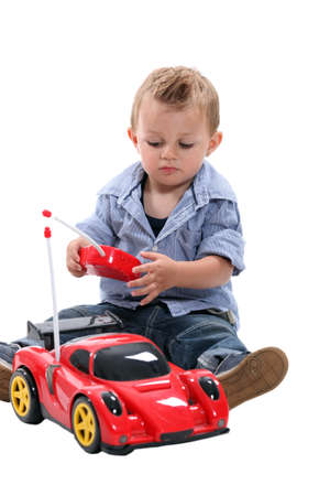 remote control: Cute little boy playing with a remote controlled car  Stock Photo