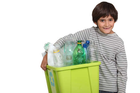 all smiles: child all smiles holding recycling bin Stock Photo