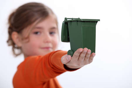 Child holding mini recycling bin photo