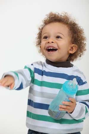 safe drinking water: Little boy with bottle Stock Photo