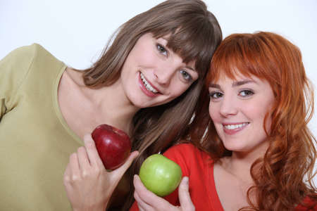 weight reduction plan: Women holding apples