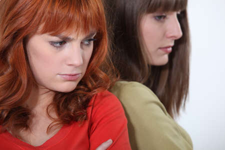 two girlfriends having a quarrel photo
