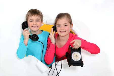 Brother and sister with old-fashioned telephone Stock Photo - 17506089