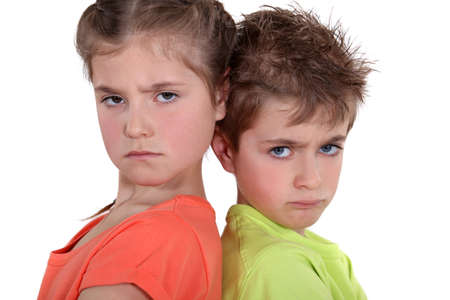 disapprove: two angry kids posing together Stock Photo
