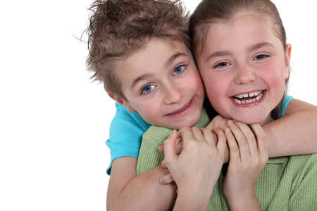 accomplices: Little boy and little girl hugging