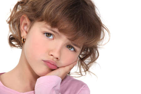 making a face: Little girl pouting Stock Photo