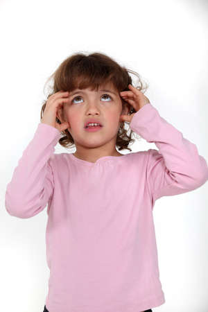 Young girl looking anxious photo