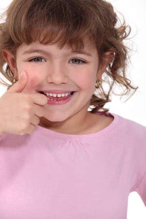 thumbsup: Little girl giving thumbs-up