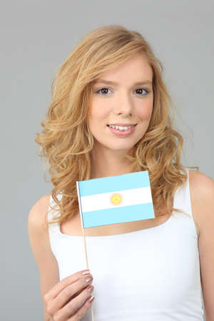 argentinean: Woman waving an Argentinean flag