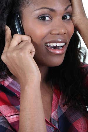 Woman receiving bad news over the phone photo