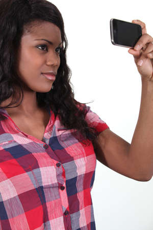 African woman taking pictures with phone photo