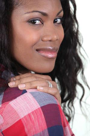 Woman wearing checked shirt photo