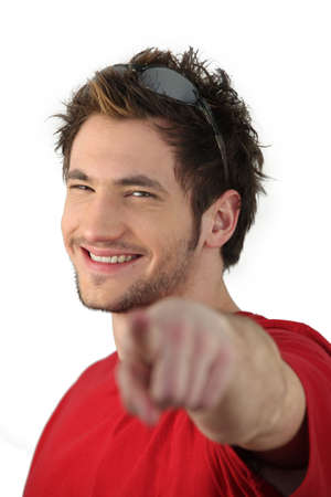 non verbal: Young man pointing his finger Stock Photo