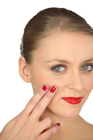 Woman with red nail varnish and lipstick photo
