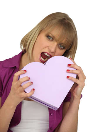 woman holding a hearth shaped box photo