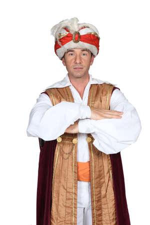 genio de la lampara: retrato de un hombre con traje Foto de archivo