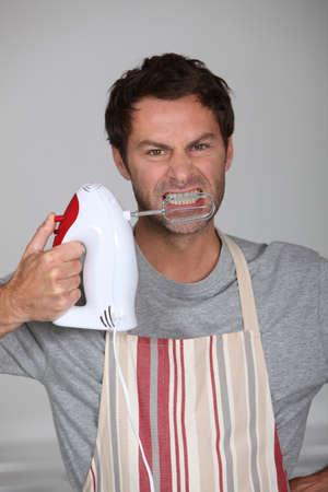 bared teeth: Aggressive chef Stock Photo