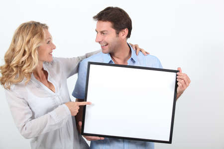 mouth couple: couple holding a frame Stock Photo