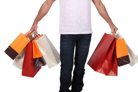 numerous: Man holding numerous shopping bags Stock Photo