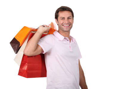 Man carrying shopping bags photo