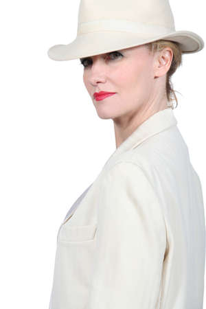 Profile photo of blond woman wearing cream coloured suite with matching hat photo